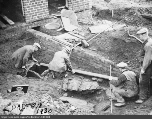 Workmen helping excavate a cist cemetery in advance of construction of a school in Cambuslang (c) RCAHMS image number SC01338023